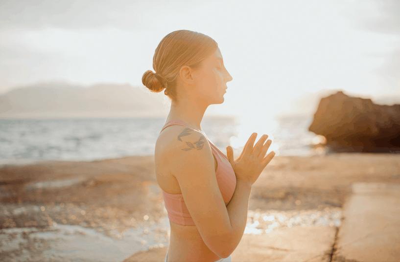 Meditation at the beach sunset