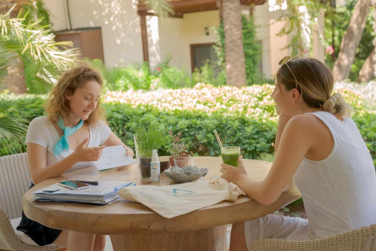 girls sitting on wellness retreat