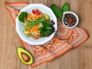raw vegan salad and tasty sauces