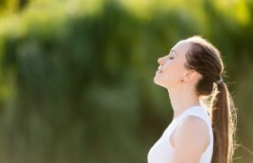Woman Taking Deep Breathe